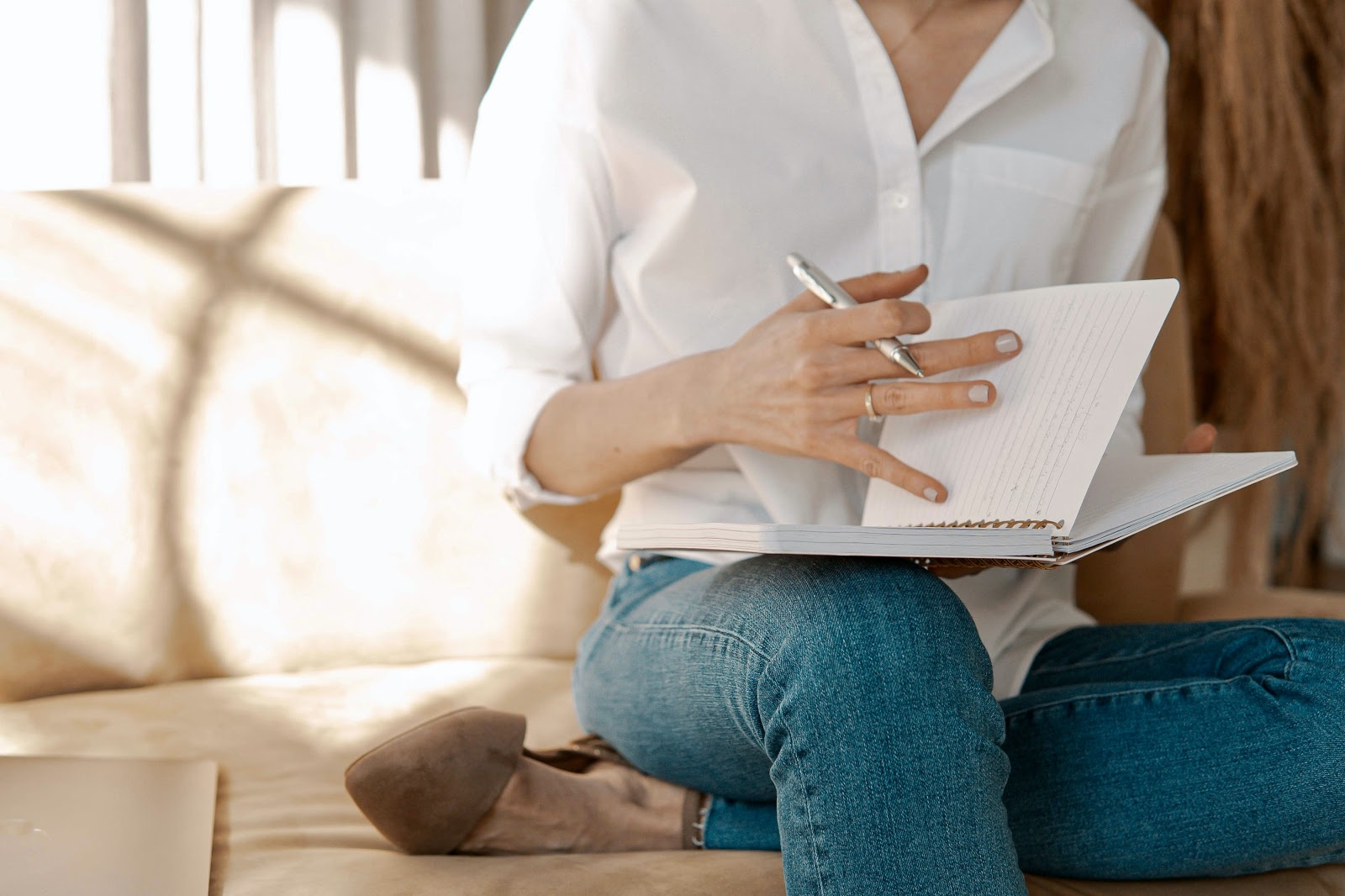 female-writer-flipping-pages-on-her-notebook